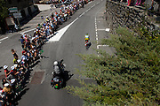 Flumet - Thursday, Jul 20 2006: Stage 17, Saint-Jean-de-Maurienne to Morzine, 200.5 km. Floyd Landis, Phonak, rides through Flumet chasing the lead group that had ridden through earlier. Landis went on to win the stage which set him up to take back the yellow jersey (maillot jaune) from Oscar Sio Perreiro at the end of the time trial two days later.   (Photo by Peter Horrell / http://www.peterhorrell.com)