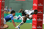 Action from the 2008-2009 opening event in the IRB World sevens series, the Emirates Airline Dubai Sevens 2008 tournament at the new Sevens Stadium in Dubai on 28th/29th November 2008. Samoa v Fiji