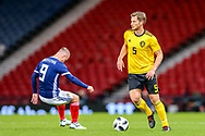 Jan Vertonghen (#5) of Belgium take the ball away from the on rushing Leigh Griffiths (#9) of Scotland during the International Friendly match between Scotland and Belgium at Hampden Park, Glasgow, United Kingdom on 7 September 2018.