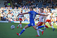 Peterborough United midfielder Mark O'Hara (8) gets in a cross during the EFL Sky Bet League 1 match between Peterborough United and Blackpool at The Abax Stadium, Peterborough, England on 29 September 2018.