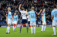 Craig Dawson celebrates the first goal by Saido Berahino during the The FA Cup match between West Bromwich Albion and Gateshead at The Hawthorns, West Bromwich, England on 3 January 2015. Photo by Alan Franklin.