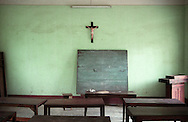 A crucifix is sticked on a wall in an empty classroom of Nam Dinh province, Vietnam, Asia