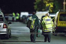 © Licensed to London News Pictures . 12/10/2015 . Eccles , UK . Police and paramedics on the scene on Gillingham Road , Eccles where it's reported a woman and a child were both shot this evening (12th October 2015) . It's reported the victims are a woman and her young son who were shot in the legs . It's the fifth shooting in Manchester in under a week . Photo credit : Joel Goodman/LNP