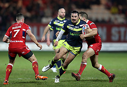 Wakefiekd Trinity's Justin Hero (centre) is tackled during the Betfred Super League match at Craven Park, Hull.