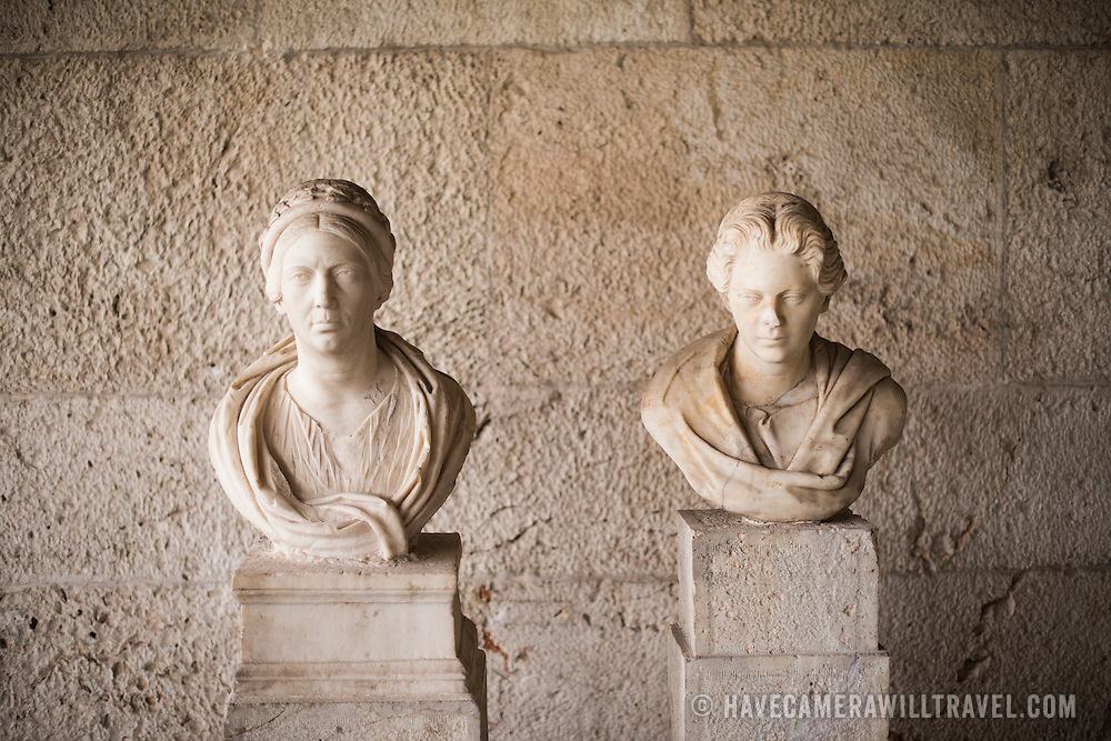 Two portrait busts of Roman matrons. The one on the left dates to the 3rd century AD, while the one on the right dates to the 2nd century AD. The Stoa of Attalos is a 1950s recreation of a long pavilion that was originally built around 150 BC. It was part of the Ancient Agora (market). It now houses the Museum of the Ancient Agora, which includes clay, bronze and glass objects, sculptures, coins and inscriptions from the 7th to the 5th century BC, as well as pottery of the Byzantine period and the Turkish conquest.