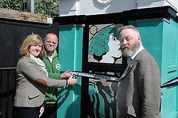 Scottish Green party candidates for the Lothians Alison Johnstone (left) and Andy Wightman (centre) officially unveil the latest piece of art by Leith-based artist Stewart Bremner (right), a specially-designed and painted decommissioned police box on Leith Walk, Edinburgh.<br /> <br /> <br /> © Dave Johnston/ EEm