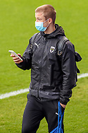AFC Wimbledon midfielder Jaakko Oksanen (16) arriving for the game wearing face mask during the EFL Sky Bet League 1 match between AFC Wimbledon and Lincoln City at Plough Lane, London, United Kingdom on 2 January 2021.