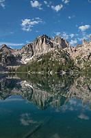 Monte Verita Peak mirrored in still waters of Baron Lake. Sawtooth Mountains Wilderness Idaho
