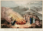 Signal fires in the Slievenamon Mountains - Ireland 1848. Scene during unrest in Tipperary showing three armed men keeping lookout while others group round the fire. Lithograph published by N Currier, New York, 1848.