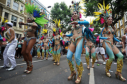 © Licensed to London News Pictures. 27/08/2012. London,UK. People take part in the Notting Hill Carnival in West London today 27th August 2012.The annual carnival, which is the largest of its kind in Europe, is expected to attract around 1 million people.Photo credit : Thomas Campean/LNP..