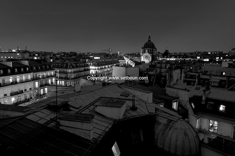 France. Paris. Elevated view.  basilic church of the sacre coeur in montmartre, roofs view.   from the hotel Hyatt madelaine