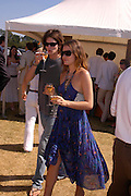 Jessie Leonard and James Burke. Veuve Clicquot Gold Cup Final at Cowdray Park. Midhurst. 17 July 2005. ONE TIME USE ONLY - DO NOT ARCHIVE  © Copyright Photograph by Dafydd Jones 66 Stockwell Park Rd. London SW9 0DA Tel 020 7733 0108 www.dafjones.com