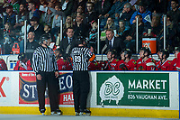 KELOWNA, CANADA - APRIL 8: Portland Winterhawks' head coach Mike Johnston speaks to referee Mike Campbell from the bench during second period on April 8, 2017 at Prospera Place in Kelowna, British Columbia, Canada.  (Photo by Marissa Baecker/Shoot the Breeze)  *** Local Caption ***
