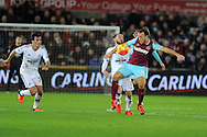 Leon Britton of Swansea city challenges Mark Noble of West Ham Utd (r).Barclays Premier league match, Swansea city v West Ham Utd at the Liberty Stadium in Swansea, South Wales  on Sunday 20th December 2015.<br /> pic by  Andrew Orchard, Andrew Orchard sports photography.