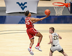 Feb 13, 2021; Morgantown, West Virginia, USA; Oklahoma Sooners guard Alondes Williams (15) shoots a layup during the first half against the West Virginia Mountaineers at WVU Coliseum. Mandatory Credit: Ben Queen-USA TODAY Sports