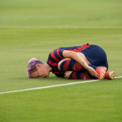 Key forward MEGAN RAPINOE of the USA team takes a painful fall during the first half of the US Women's National Team (USWNT) victory over Nigeria, 2-0 in the inaugural match of Austin's new Q2 Stadium. The U.S. women's team, an Olympic favorite, is wrapping up a series of summer matches to prep for the Tokyo Games. She later walked off the field on her own.