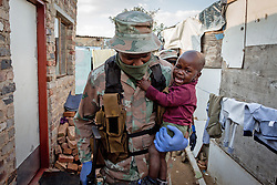 BEIJING, April 22, 2020  A soldier of South African National Defense Force carries a baby in his arm in Johannesburg, South Africa, April 20, 2020..  South Africa's COVID-19 cases have surged to 3,300, up by 142 from the previous count, Health Minister Zweli Mkhize said Monday. (Photo by Yeshiel/Xinhua) (Credit Image: © Yeshiel/Xinhua via ZUMA Wire)
