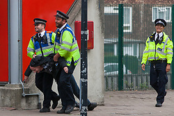 London, UK. 3 September, 2019. Metropolitan Police officers carry an activist on the second day of a week-long carnival of resistance outside ExCel London against DSEI, the world's largest arms fair. The second day's events were organised around a theme of No Faith In War and were attended by representatives of many faith groups including a significant number of Quakers.