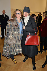 Left to right, ? and LOUISA GUINNESS at the opening private view of 'A Strong Sweet Smell of Incense - A portrait of Robert Fraser, held at the Pace Gallery, Burlington Gardens, London on 5th February 2015.