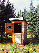 Brown Bear Paw carved window in outhouse at National Park Service Ranger Cabin, Silver Salmon Creek, Lake Clark National Park, Alaska.