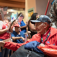 Lawrence Talamante, 94, returns home to New Mexico as he is greeted by crowds of passengers, friends, and supporters at the Albuquerque International Sunport in Albuquerque Jun. 07.