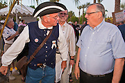 15 APRIL 2011 - PHOENIX, AZ: PATRICK LACEY, a supporter of the Tea Party, talks to Maricopa County Sheriff JOE ARPAIO during a Tea Party rally in Phoenix, AZ, Friday. About 500 supporters of the Tea Party movement rallied Friday at the Arizona State Capitol to mark tax day. They protested high taxes, the federal deficit, the debt limit and immigration policy. About 50 pro-immigrant protesters held a counter rally at the capitol. At least one person was arrested, and others led away by police after several shouting matches between Tea Party supporters and the immigrants rights protesters broke out.     Photo by Jack Kurtz