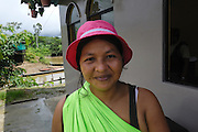 Ecuador, May 10 2010: Ninke Re's wife poses with her new pink hat. Copyright 2010 Peter Horrell