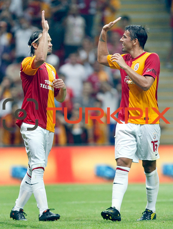 Galatasaray's Milan BAROS (R) celebrate his goal with team mate during their Friendly soccer match Galatasaray between Liverpool at the TT Arena at Arslantepe in Istanbul Turkey on Saturday 28 July 2011. Photo by TURKPIX