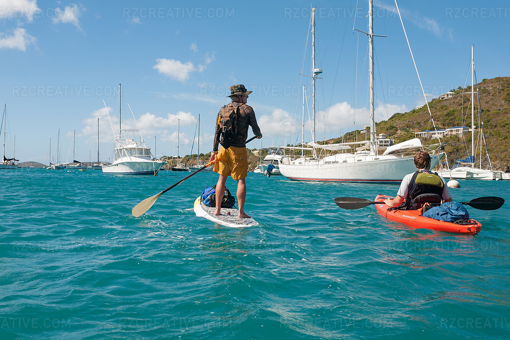 Ted Rutherford and Mark Anders paddling in Great Cruz Bay on the island of St. John in the U.S. Virgin Islands. © Robert Zaleski / rzcreative.com<br /> —<br /> To license this image contact: robert@rzcreative.com