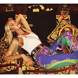 """Candice Swanepoel releases a photo on Instagram with the following caption: """"Versace on the couch \ud83c\udfb6 #gianniversace"""". Photo Credit: Instagram *** No USA Distribution *** For Editorial Use Only *** Not to be Published in Books or Photo Books ***  Please note: Fees charged by the agency are for the agency's services only, and do not, nor are they intended to, convey to the user any ownership of Copyright or License in the material. The agency does not claim any ownership including but not limited to Copyright or License in the attached material. By publishing this material you expressly agree to indemnify and to hold the agency and its directors, shareholders and employees harmless from any loss, claims, damages, demands, expenses (including legal fees), or any causes of action or allegation against the agency arising out of or connected in any way with publication of the material."""