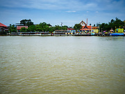 02 AUGUST 2018 - PAK KRET, NONTHABURI, THAILAND:  Ko Kret as seen from Pak Kret. Ko Kret (also spelled Koh Kret) is a small island in the Chao Phraya River in Nonthaburi province north of Bangkok. It is about 2 km long and 1 km wide. It has seven main villages, the largest and most populous being Ban Mon. Ko Kret was created in 1722 when a canal was dug in the Chao Phraya River to bypass a bend. Most of the people on the island are ethnically Mon, from the hills of western Thailand and eastern Myanmar (Burma). The island is popular as a weekend daytrip from Bangkok. The island is famous for the Mon style pottery made on the island.      PHOTO BY JACK KURTZ