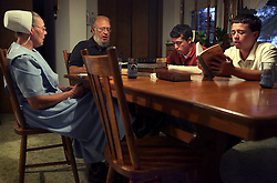 The Amish family of Jerry Schlabach sings hymns after dinner at their home in Berlin, Ohio, Oct. 13, 2009.