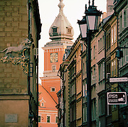 The Royal Castle seen through a narrow street of the old city, Warsaw, Poland