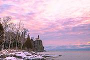 Sunrise at Split Rock Lighthouse on a cold, January morning along Lake Superior. Two Harbors, Minnesota, USA.