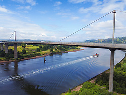Last sea going paddle steamer Waverley sailing down the River Clyde under the Erskine Bridge on a summer cruise to Scottish Lochs, Erskine, Scotland, UK