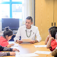 Apache County Rural School Teacher of the Year Duane Yazzie begins a reading exercise with students at Tséhootsooi Diné Bi Ołta' School in Window Rock Wednesday.