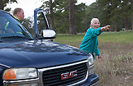 Eleanor Fairchild confronts a detail police man telling him he is tresspassing and showing him the boundries of TransCanada's work area . The easment  work area TransCanada has taken from her is clearly marked.
