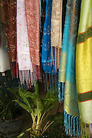Thai Silk at Chatuchak Market - sometimes written Jatujak or Weekend Market in Bangkok is the largest market in Thailand, and one of the largest of the world.  Frequently called J.J. it covers over 35 acres and contains more than 5,000 stalls not counting wandering vendors and street entertainers. It is estimated that the market receives between 200,000 and 300,000 visitors each day. Most stalls are only open on Saturdays and Sundays. The market offers a wide variety of products including household items, clothing, Thai handicrafts, religious artifacts, collectibles, foods, and even live animals.
