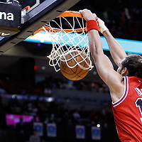 06 March 2011: Chicago Bulls center Joakim Noah (13) dunks the ball during the Chicago Bulls 87-86 victory over the Miami Heat at the AmericanAirlines Arena, Miami, Florida, USA.