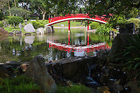 The Singapore Japanese Garden is based on Japanese gardens from the Muromachi period (1392 – 1568) to the Momoyama period (1568 – 1615).  The garden  includes  a karesansui dry garden which exudes a sense of peace and tranquility with its minimalist and abstract design.The garden is made up of arched bridges, stone lantern and ponds faithfully recreating traditional Japanese gardening style. The Singapore Japanese Garden is within the Chinese Garden complex, also known as Jurong Gardens, was made  in 1975 and designed by Prof. Yuen-chen Yu, an architect from Taiwan,. The garden's concept is based on the integration of architectural features within the natural environment. The garden is modeled along the northern Chinese imperial styles of landscaping.  In Chinese gardens, bridges play a critical role and the most important structures may denote a specific character.