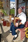 Missouri MO USA, An old accordion player playing Polka in Kimmswick, MO. October 2006