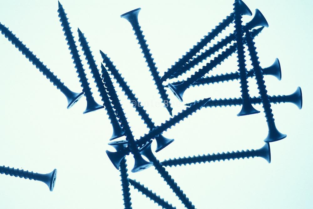 backlit pile of large screws