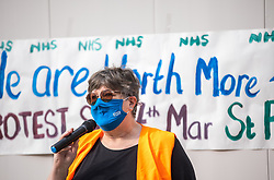 © Licensed to London News Pictures. 07/03/2021. Manchester, UK. Event organiser , mental health nurse KAREN REISSMANN (61) , speaks at the event . Nurses and their supporters protest in St Peter's Square in Manchester City Centre over the British Government proposing a one percent pay increase to nurses' salaries . Photo credit: Joel Goodman/LNP