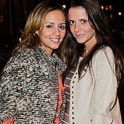 NLD/Amsterdam/20120308 - Presentatie nieuwe collectie voor Louis Vuitton, Laila Sinouh(oranje pakje) en partner Kevin Strootman