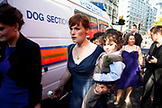 "Wedding party tries to make it's way to St Pauls, but has to move around police vans to make their way through. Occupy London protest, October 15th 2011. Protest spreads from the US with this demonstrations in London and other cities worldwide. The 'Occupy' movement is spreading via social media. After four weeks of focus on the Wall Street protest, the campaign against the global banking industry started in the UK this weekend, with the biggest event aiming to ""occupy"" the London Stock Exchange. The protests have been organised on social media pages that between them have picked up more than 15,000 followers. Campaigners gathered outside  at midday before marching the short distance to Paternoster Square, home of the Stock Exchange and other banks.It is one of a series of events planned around the UK as part of a global day of action, with 800-plus protests promised so far worldwide.Paternoster Square is a private development, giving police more powers to not allow protesters or activists inside."