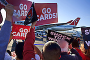 Jan. 26, 2009 -- PHOENIX, AZ: Arizona Cardinals fans cheer and wave placards during a pep rally for the team at Sky Harbor Airport in Phoenix after the team left for Tampa, FL, and the Super Bowl. The Arizona Cardinals are in the Super Bowl for the first time in the team's history. They defeated the Philadelphia Eagles to win the NFC Championship on Jan 18. With a record of 9 - 7 they have one of the worst records of any team to make the Super Bowl. Before this year they had a total of two playoff victories in the team's 111 year history, in 1947 when they won the league championship, and 1998 in a wild card game against the Dallas Cowboys. They face the Pittsburgh Steelers in Tampa on Feb. 1.    Photo By Jack Kurtz / ZUMA Press