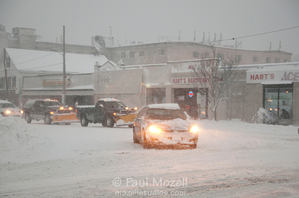 Little morning rush hour traffic moves in the small Massachusetts town of Wakefield during a major blizzard