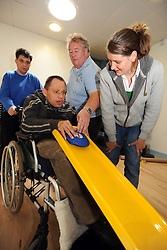People with learning disabilities play  a form of 'New Age Curling' as part of a Sport Ability Day North Yorkshire,