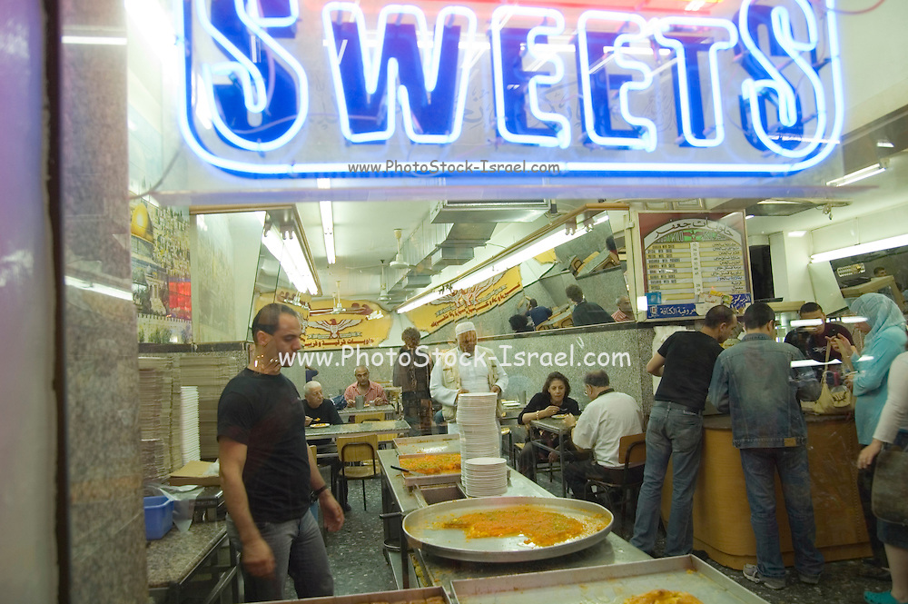 The Market, Jerusalem old city, Israel. A store making and selling Knafeh a sweet cheese pastry