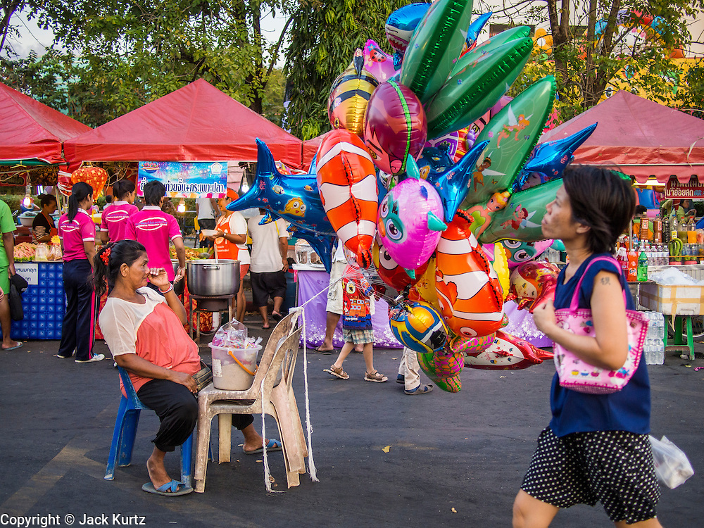 06 FEBRUARY 2014 - HAT YAI, SONGKHLA, THAILAND: An inflatable toy vendor at the Chinese New Year Festival in Hat Yai. Hat Yai was originally settled by Chinese immigrants and still has a large ethnic Chinese population. Chinese holidays, especially Lunar New Year (Tet) and the Vegetarian Festival are important citywide holidays.     PHOTO BY JACK KURTZ